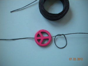 peace sign and waxed string