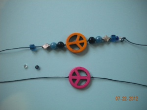 adding beads to the bracelet