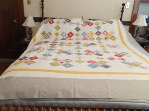 yellow and grey quilt